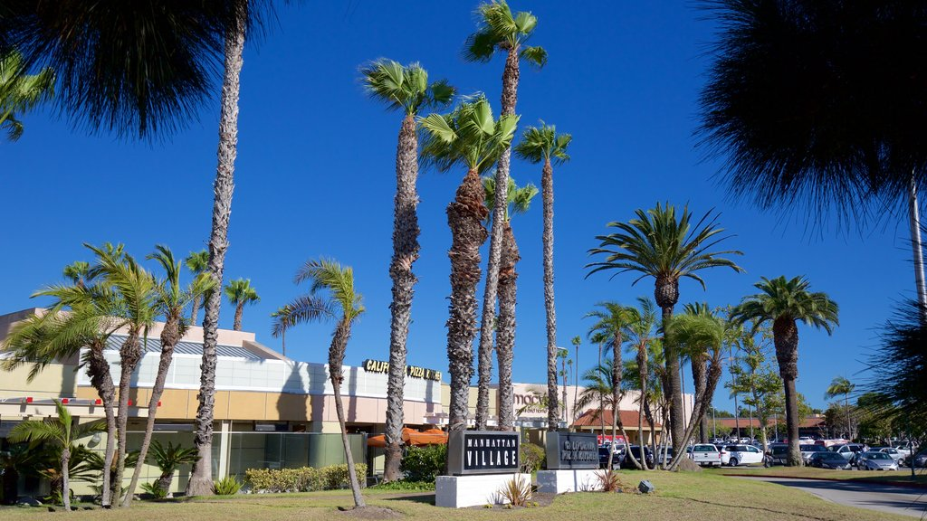 Manhattan Beach showing a garden and signage