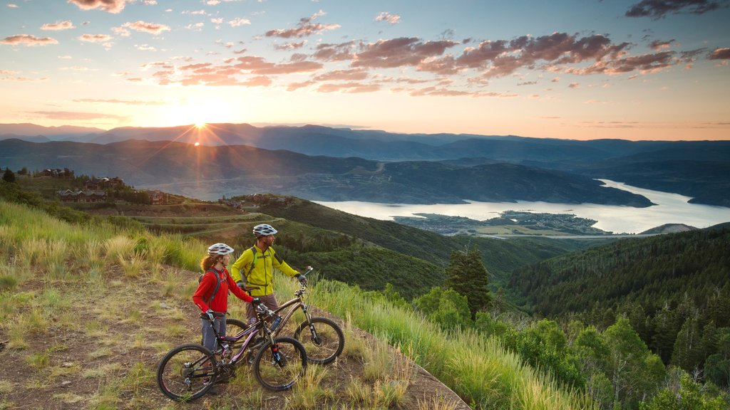 Deer Valley Resort showing landscape views and a sunset as well as a small group of people