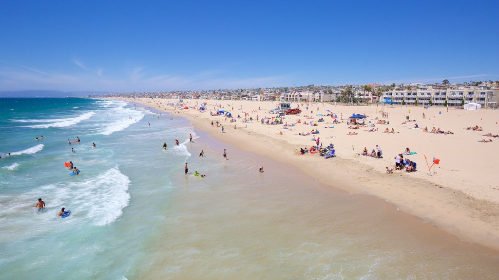 Hermosa Beach which includes general coastal views and a sandy beach as well as a large group of people