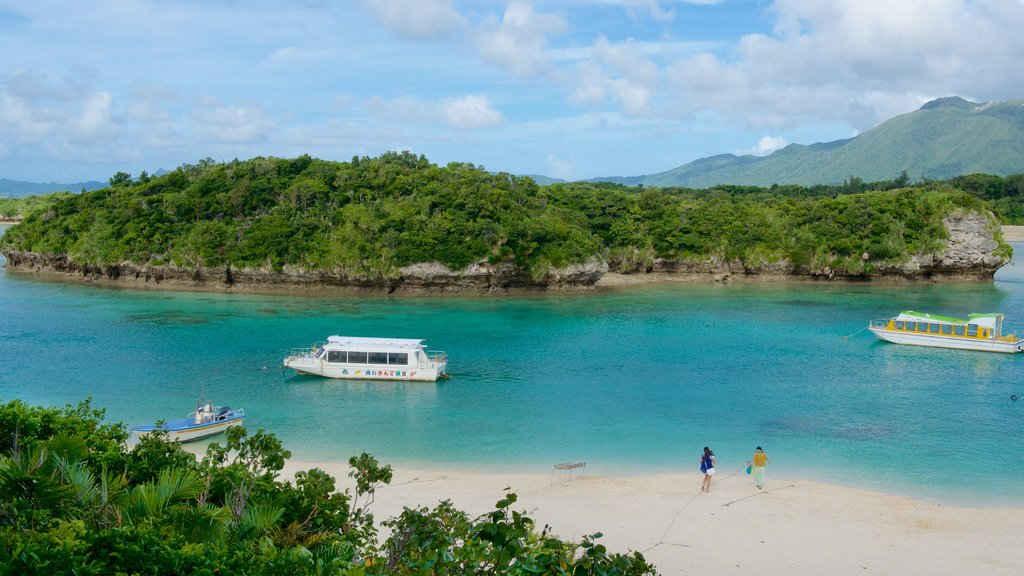 Kabira Bay Beach which includes a sandy beach and boating as well as a small group of people