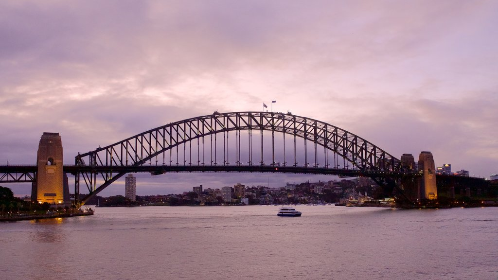 Sydney Harbour Bridge featuring boating, city views and night scenes