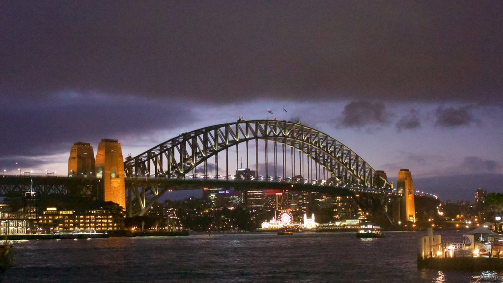 Sydney Harbour Bridge which includes boating, a city and general coastal views