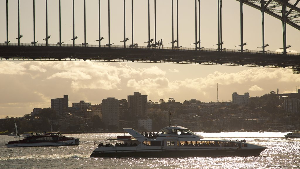 Sydney Harbour Bridge featuring a sunset, boating and a bridge