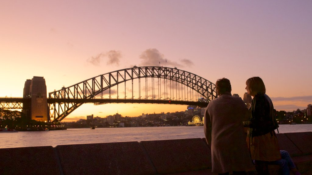 Sydney Harbour Bridge showing city views, a sunset and general coastal views
