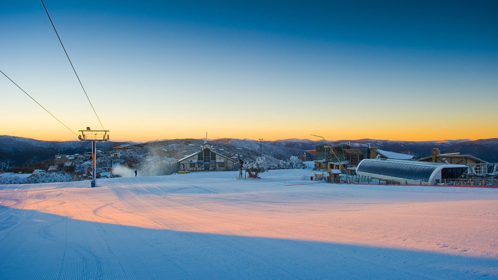 Mt. Buller Ski Slopes which includes a small town or village, a sunset and snow