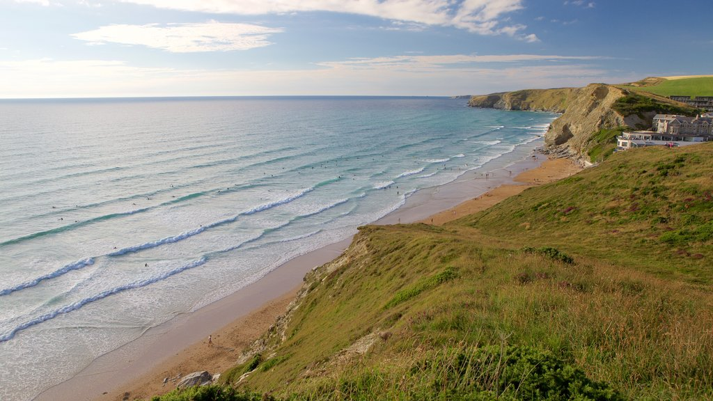 Watergate Bay featuring a sandy beach, landscape views and a coastal town