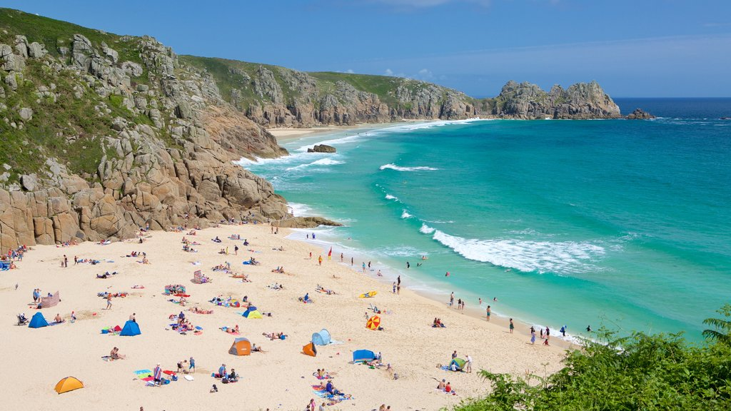 Porthcurno Beach featuring a sandy beach, landscape views and swimming
