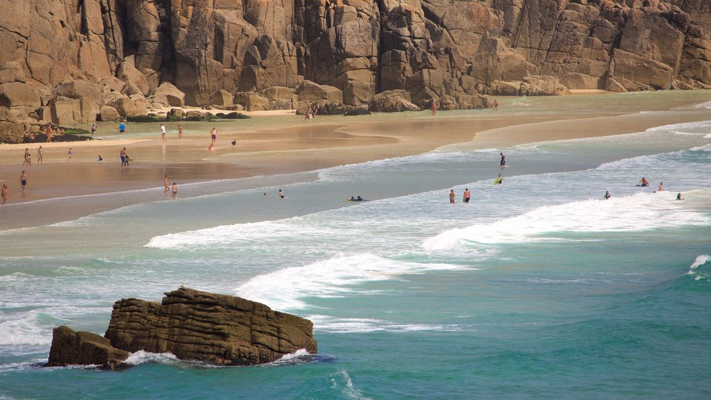 Porthcurno Beach featuring swimming, a beach and landscape views