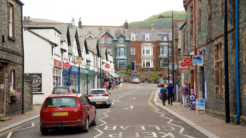Keswick which includes a coastal town, street scenes and signage