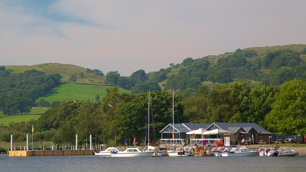 Coniston Water showing a small town or village, boating and a lake or waterhole