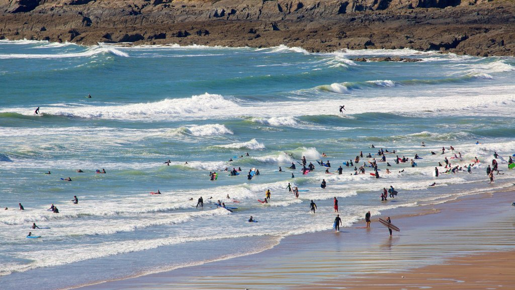 Croyde which includes swimming and a beach as well as a large group of people