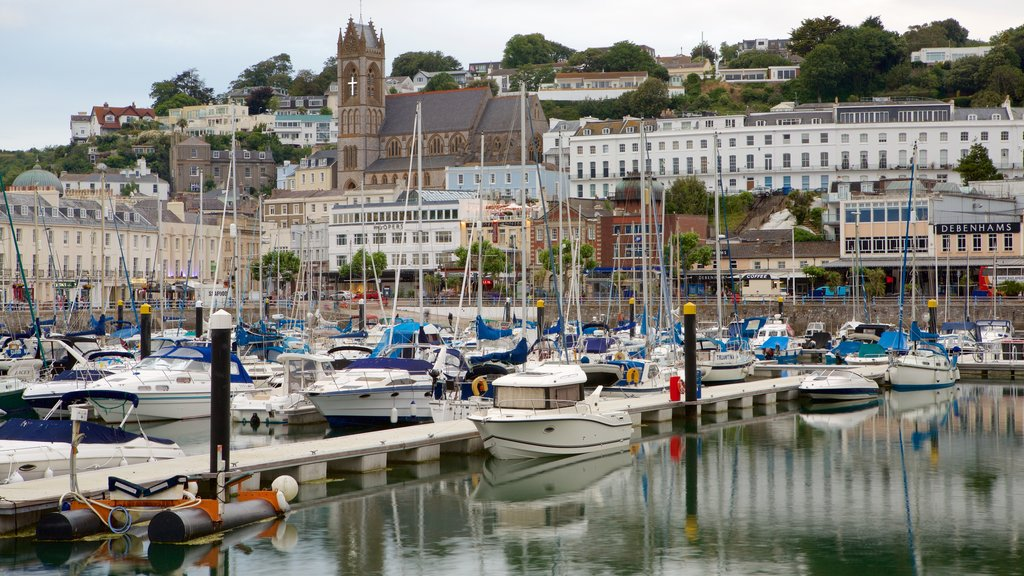 Torquay featuring boating, a bay or harbor and a coastal town
