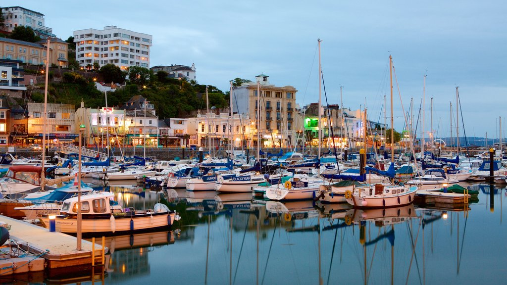 Torquay featuring a marina, boating and night scenes