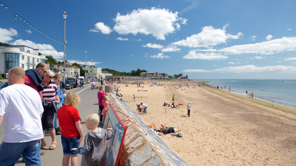 Exmouth which includes a sandy beach and a coastal town as well as a large group of people