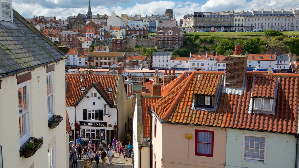Whitby featuring a small town or village and street scenes as well as a large group of people