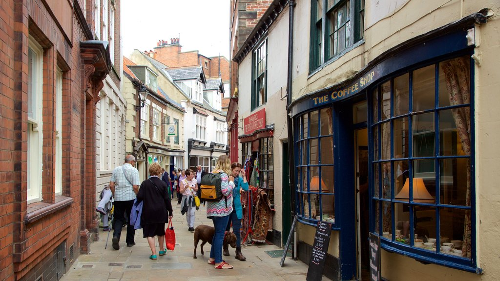 Whitby which includes street scenes, a small town or village and cafe scenes
