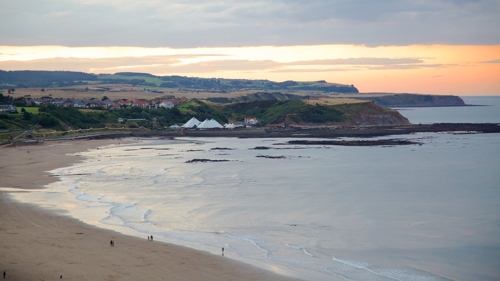 North Bay Beach showing a sunset, landscape views and a sandy beach