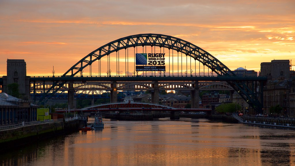 Tyne Bridge which includes a sunset, signage and a city