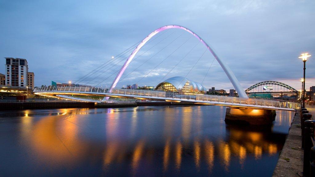 Gateshead Millennium Bridge showing a river or creek, a bridge and a city
