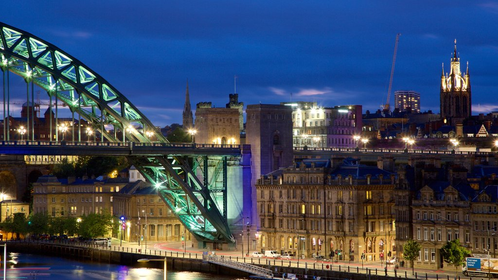 Newcastle-upon-Tyne showing a river or creek, night scenes and a city