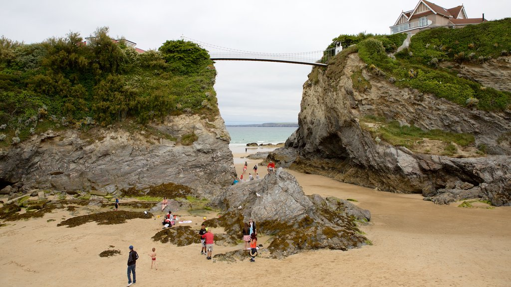 Newquay which includes a beach and a bridge