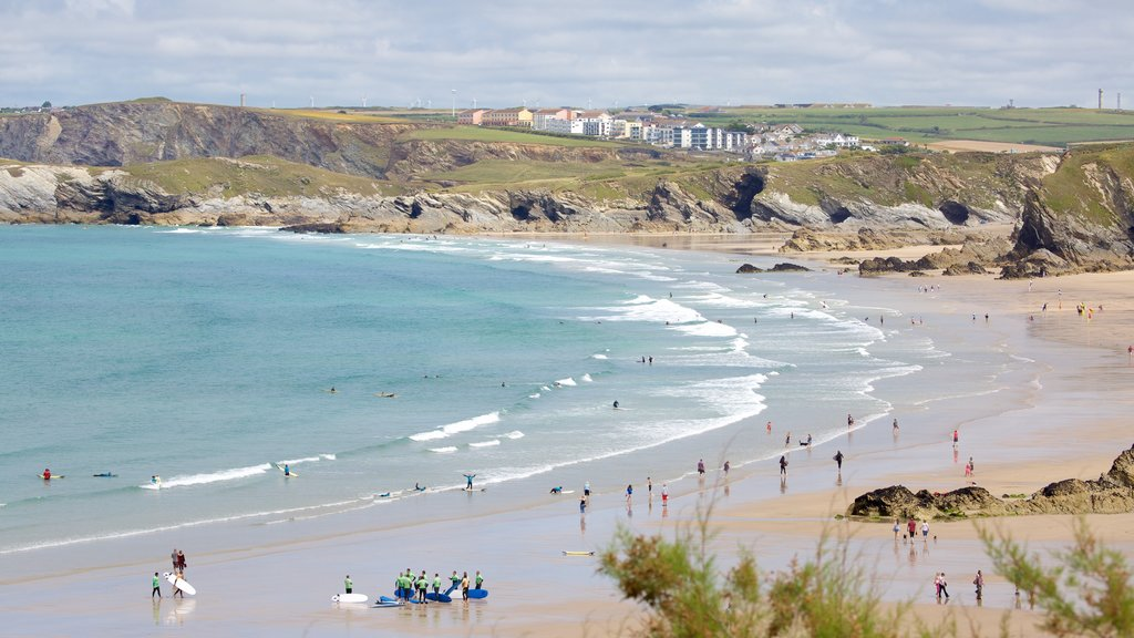 Newquay featuring landscape views and a beach as well as a large group of people