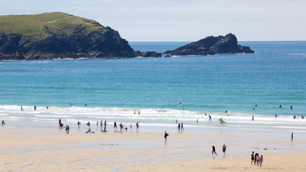 Fistral Beach featuring swimming and a beach as well as a large group of people