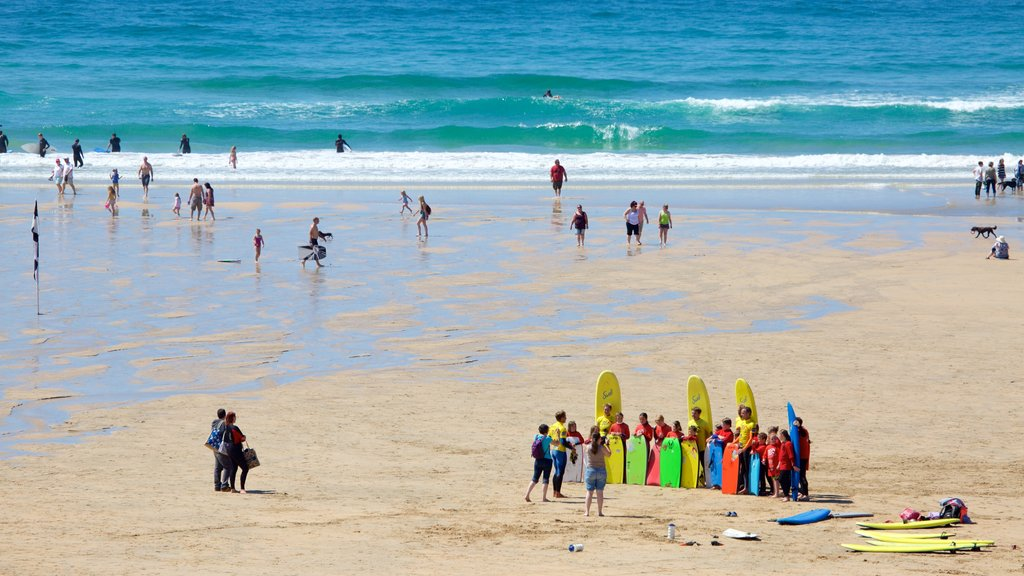 Fistral Beach which includes a beach and swimming as well as a large group of people