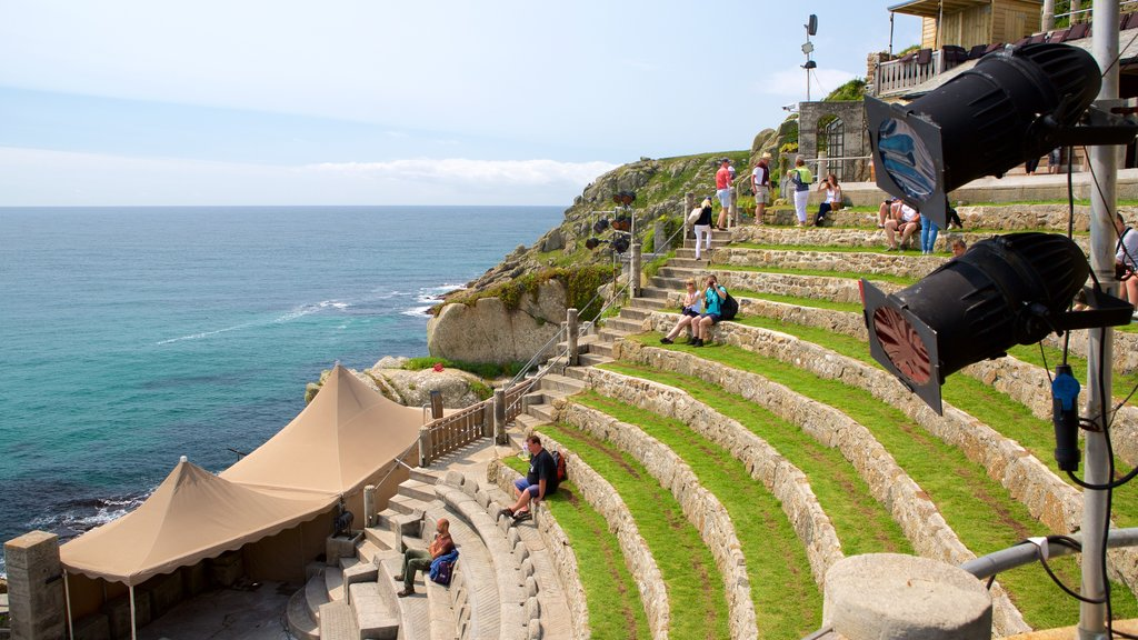 Minack Theatre showing general coastal views as well as a small group of people