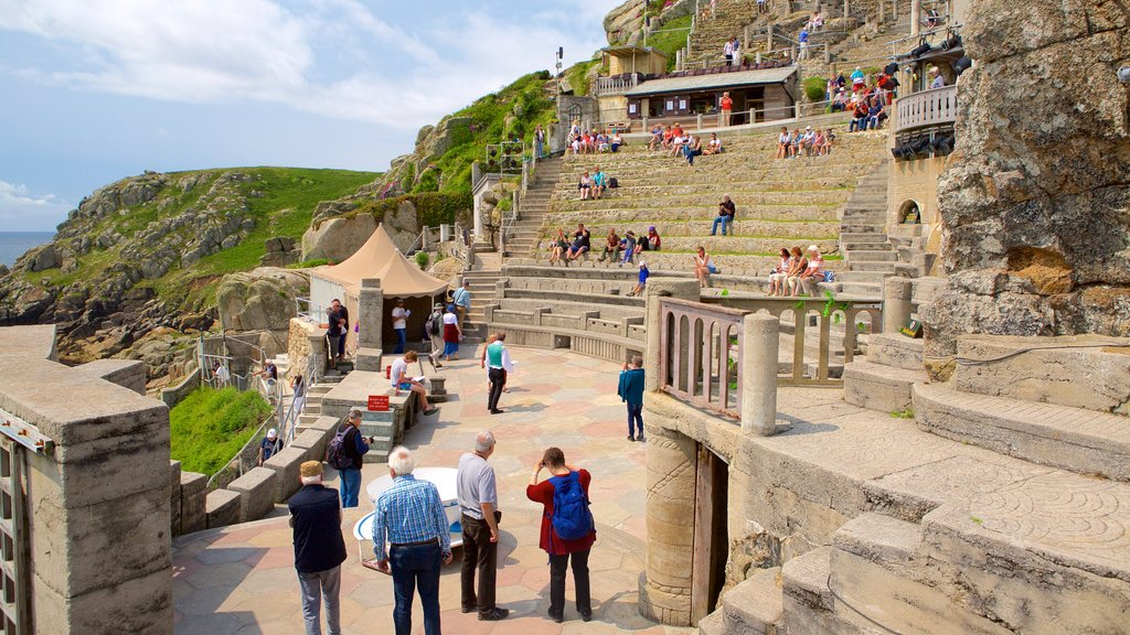 Minack Theatre which includes general coastal views as well as a large group of people