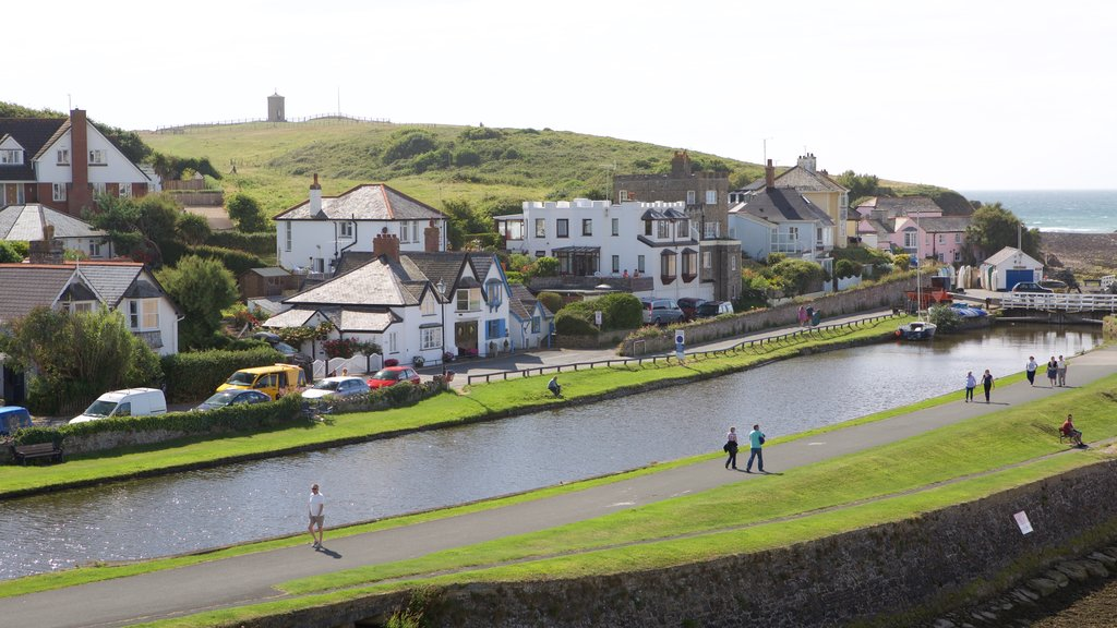 Bude which includes a small town or village and a river or creek as well as a small group of people