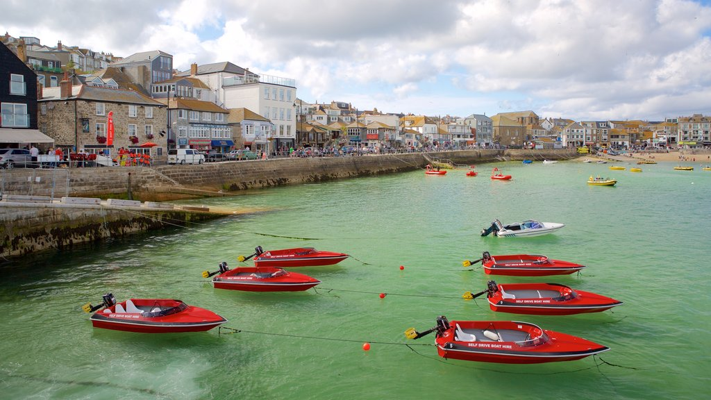 St Ives showing boating, a coastal town and rocky coastline