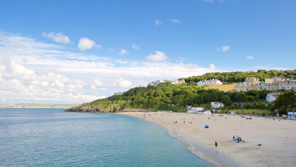 Porthminster Beach featuring a beach and a coastal town
