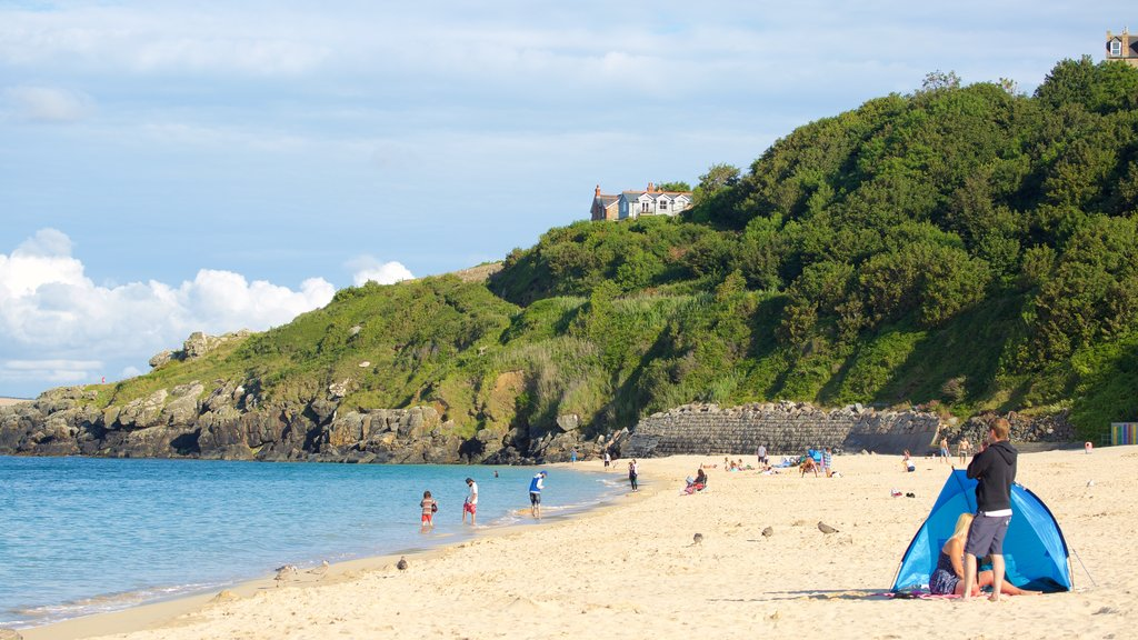 Porthminster Beach featuring swimming and a beach