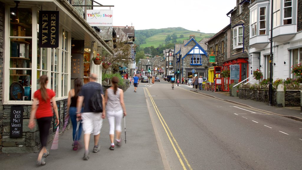 Ambleside which includes street scenes, a coastal town and signage