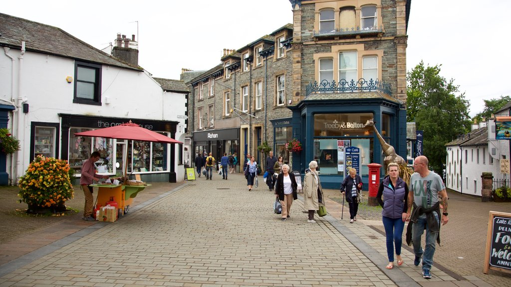 Keswick which includes signage, street scenes and cafe lifestyle