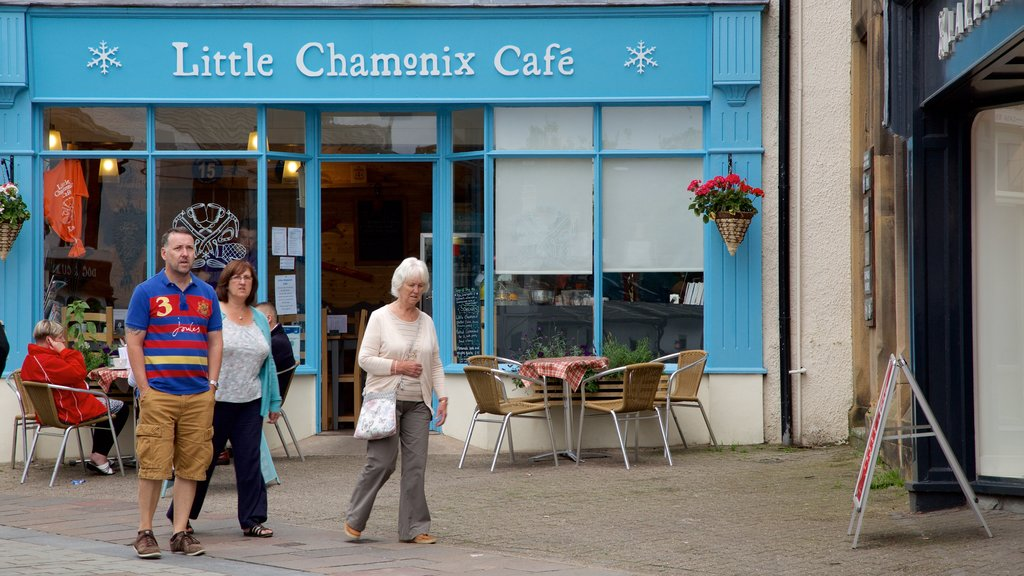Keswick featuring cafe lifestyle, signage and a small town or village