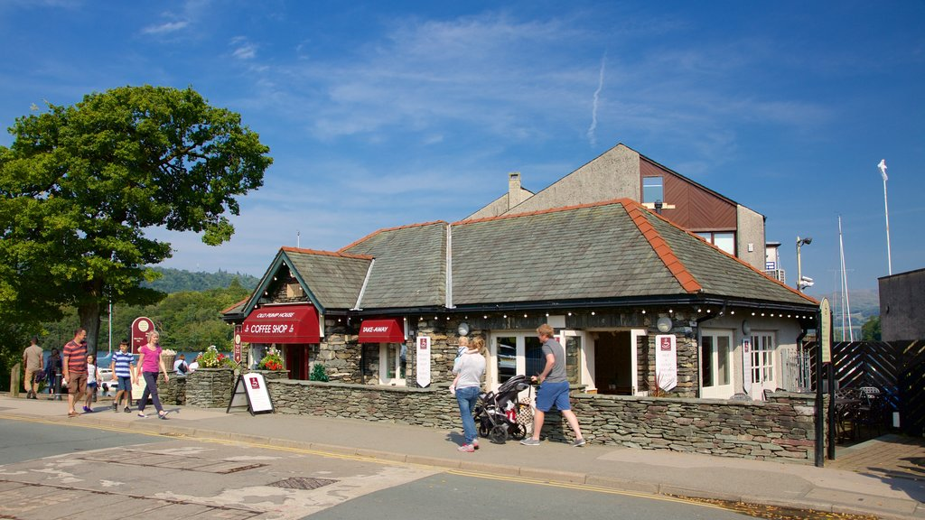 Bowness-on-Windermere which includes a small town or village, signage and cafe lifestyle