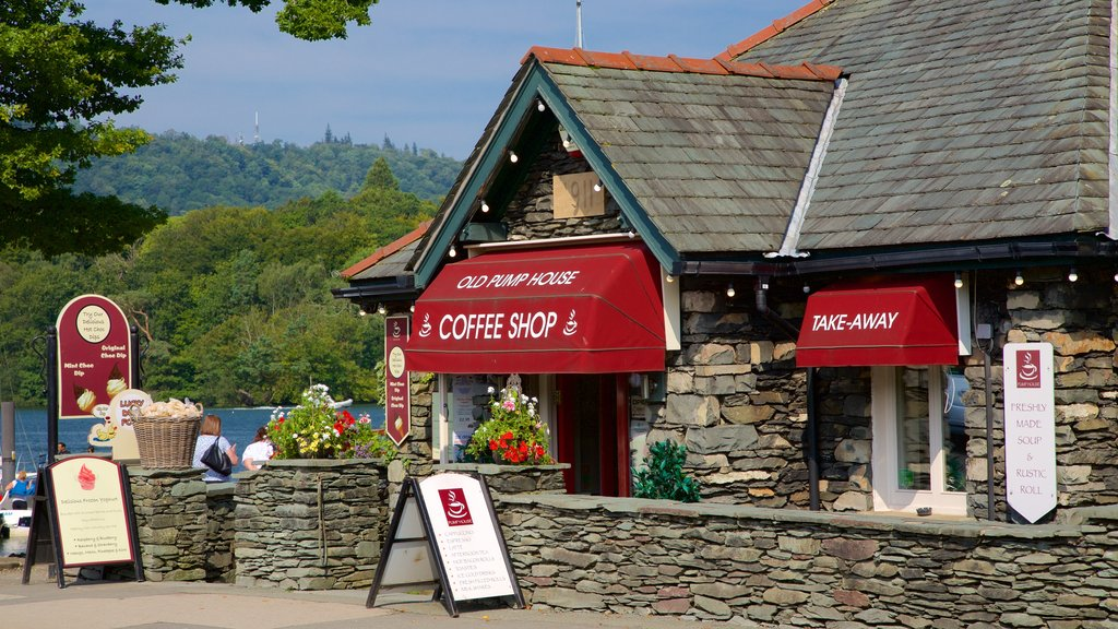 Bowness-on-Windermere which includes signage, cafe lifestyle and a small town or village