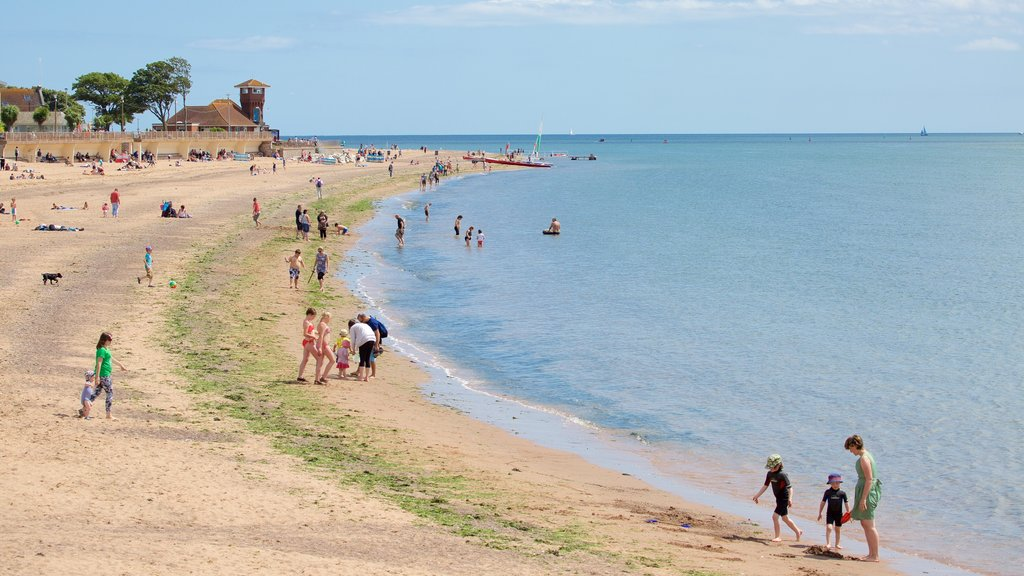 Exmouth which includes a sandy beach and swimming as well as a large group of people