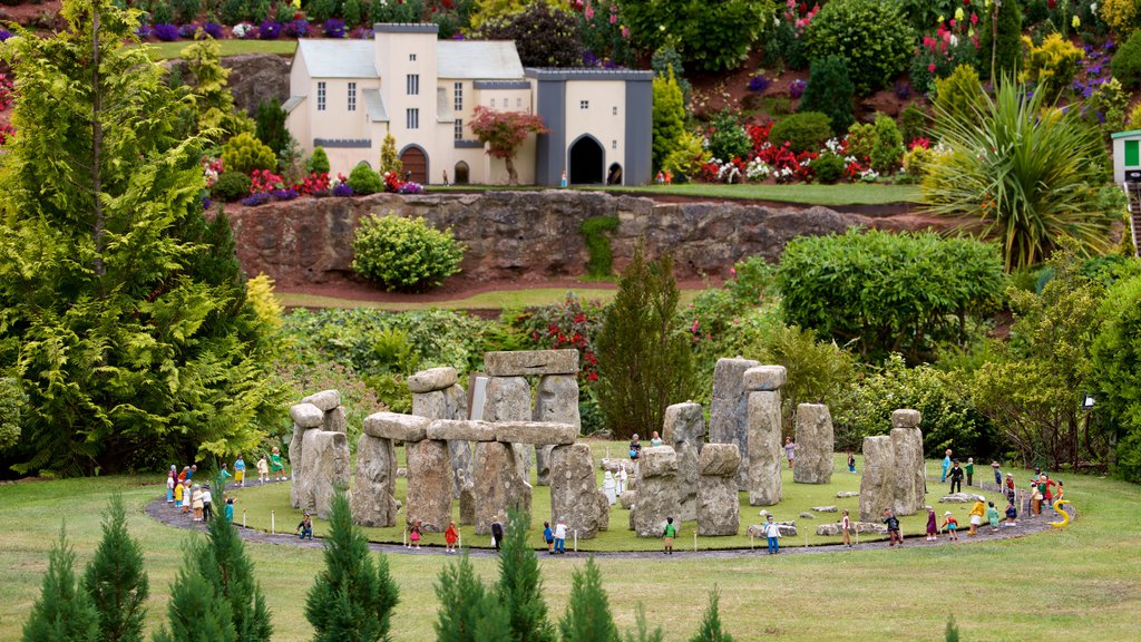 Babbacombe Model Village and Gardens featuring a park and flowers as well as a large group of people