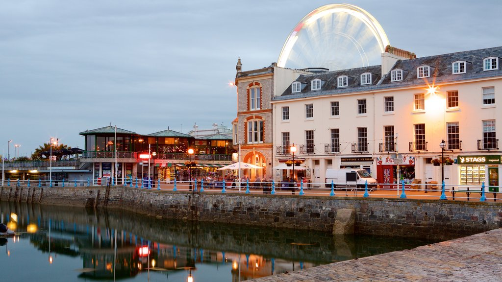 Torquay showing night scenes, a coastal town and street scenes