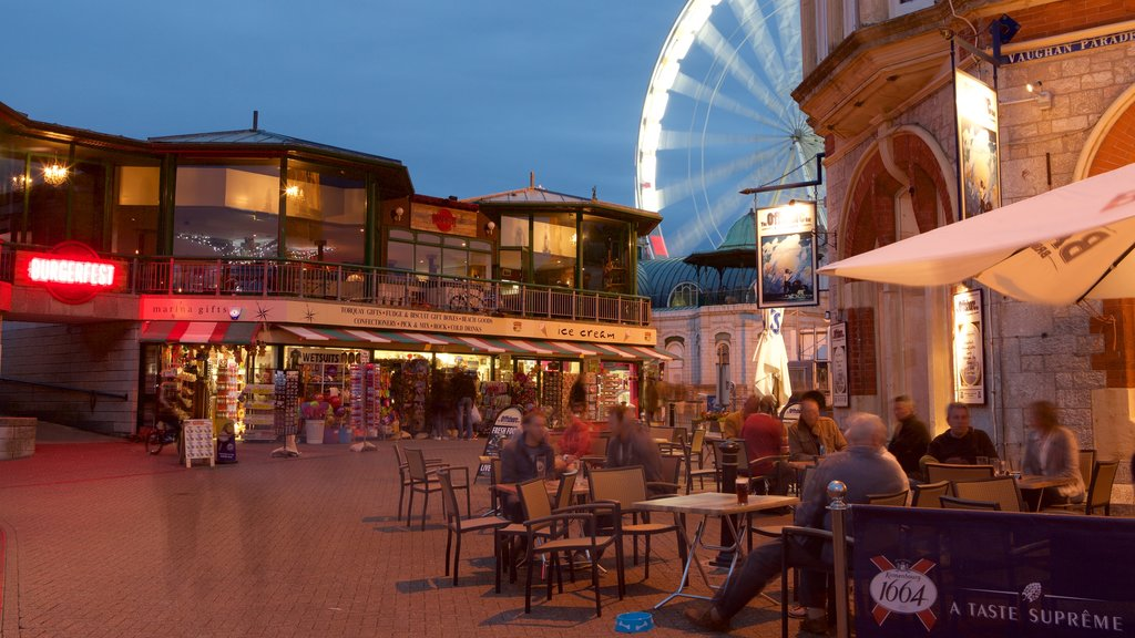Torquay which includes night scenes, rides and a square or plaza