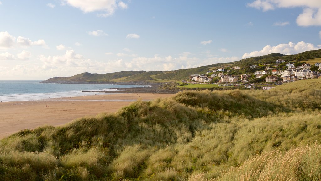 Woolacombe featuring tranquil scenes, a sandy beach and a coastal town