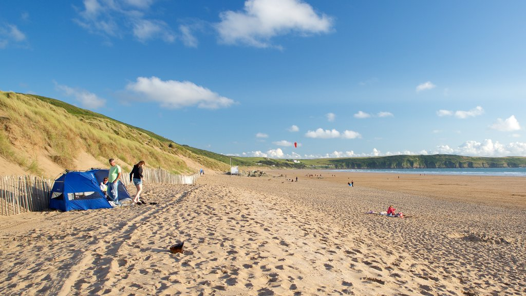 Woolacombe which includes landscape views and a sandy beach as well as a couple