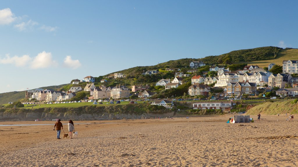 Woolacombe which includes a sandy beach and a coastal town