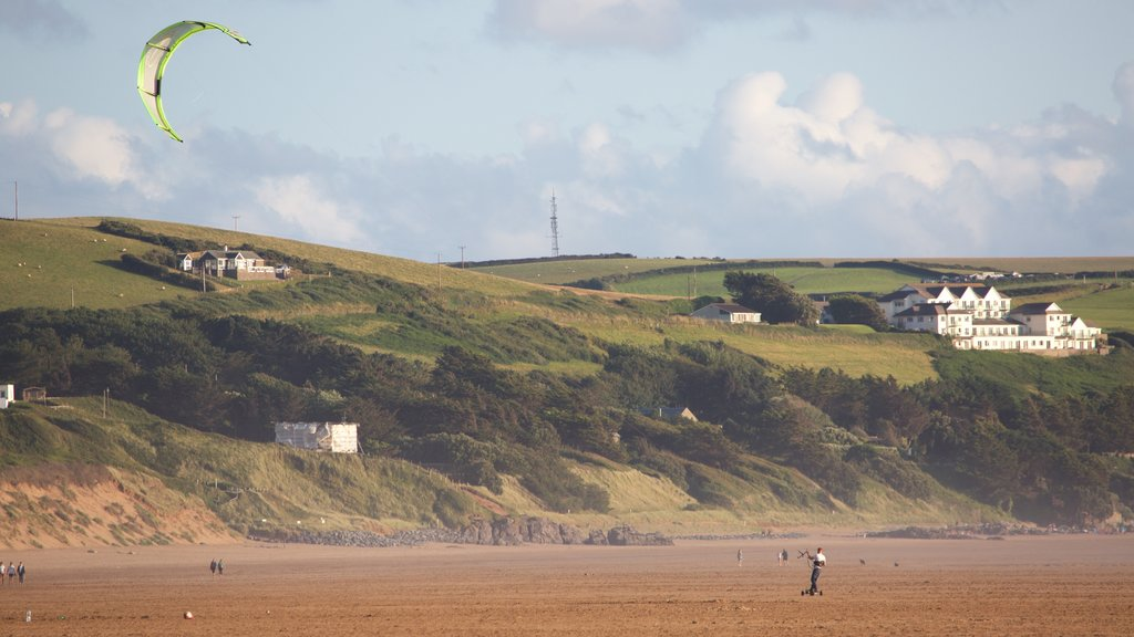 Woolacombe which includes tranquil scenes, kite surfing and a sandy beach