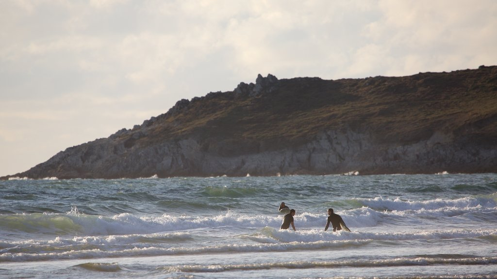 Woolacombe featuring rocky coastline, swimming and surf