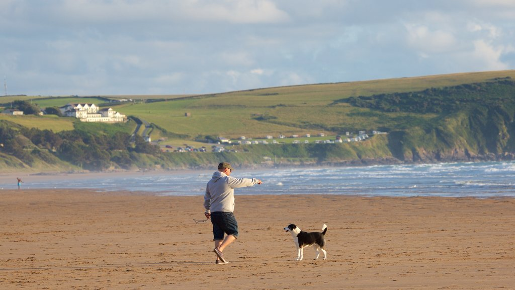 Woolacombe showing a beach as well as an individual male