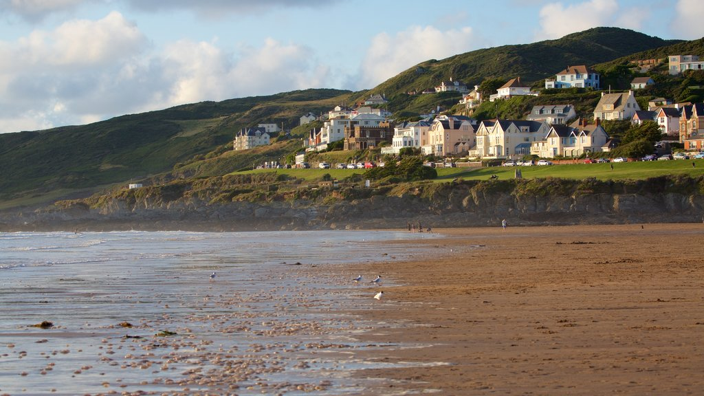 Woolacombe showing a beach and a coastal town